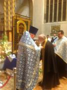 07Orthodox priest offers relic of st chad